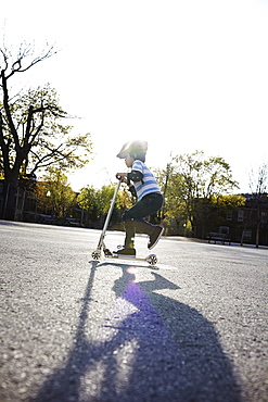 Young Boy Riding A 2-Wheeled Scooter, Montreal, Quebec, Canada