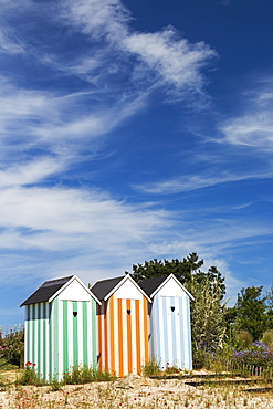 Three Colourful Striped Painted Outhouses On A Sandy Grassy Hill With Trees, Roscoff, Brittany, France