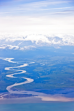 Aerial View Of A Winding River Connecting Snow-Capped Mountains To Cook Inlet, Southcentral Alaska, USA, Summer