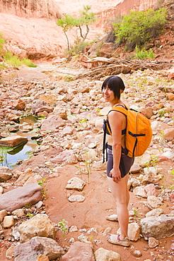 Adventurer Exploring A Desert Canyon Narrows, Capitol Reef National Park, Utah, United States Of America