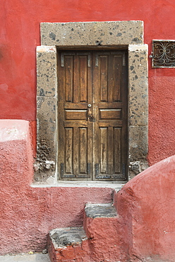 Worn Wooden Doors On A Red Painted Building, San Miguel De Allende, Guanajuato, Mexico