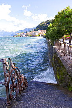 Wind Sends Lake Como Water Splashing Against A Waterfront Staircase And Sidewalk, Bellagio, Italy