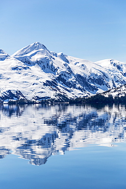 Snow Covered Mountains Reflect In The Calm Waters Of Prince William Sound In Winter, Kings Bay, Alaska, United States Of America
