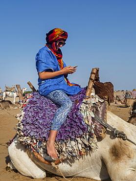 Tourist Ready For A Beach Camel Trek, Essaouira, Morocco