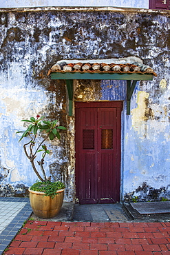 A Faded Red Door Sits Surrounded By A Weathered Blue Wall In Downtown Georgetown, Georgetown, Penang, Malaysia