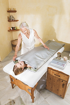 A Young Woman Laying On A Treatment Table At A Spa Getting A Treatment, Tarifa, Cadiz, Andalusia, Spain