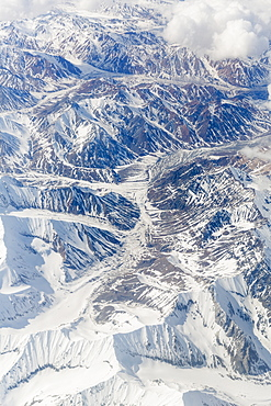 Aerial View Of A River Valley Surrounded By Snow Capped Mountains, Alaska Range, Interior Alaska, USA, Winter