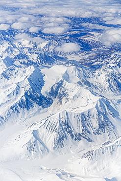 Aerial View Of Snow Covered Mountains Near Anchorage, Southcentral Alaska, USA, Spring
