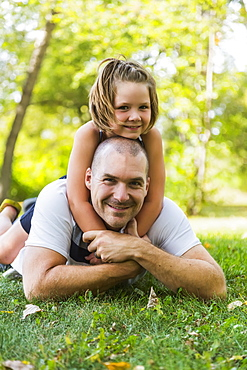 A Father And Daughter Posing And Spending Quality Time Together In A Park During A Family Outing, Edmonton, Alberta, Canada