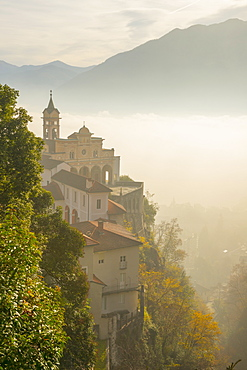 Fog Sets In Over A Church And Alpine Lake, Locarno, Ticino, Switzerland