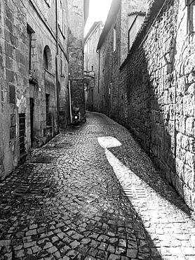 Narrow Cobblestone Alley Between Buildings, Orvieto, Umbria, Italy