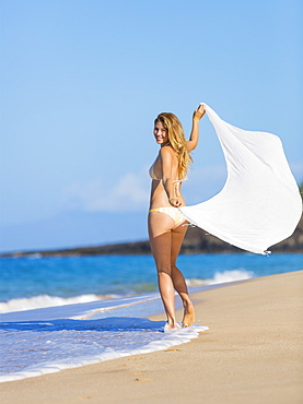Beautiful Woman In Bikini With White Scarf On The Beach. Travel And Vacation.