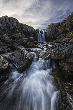 Stream Flows Over A Waterfall Along The Eastern Coast Of Iceland, Iceland