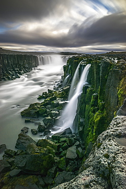 Waterfall Flowing Over Moss Covered Cliffs, Selfoss, Iceland