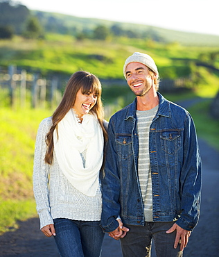 Romantic Young Couple In Love Outdoors On Country Road