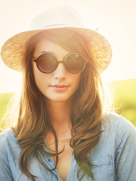 Fashion Portrait Of Beautiful Young Woman In Hat And Sunglasses Oustide, Bright Warm Sunny Color Tones