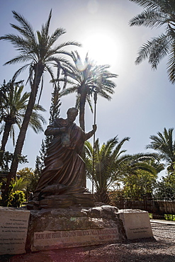 Statue Of A Peter With Blue Sky And Palm Trees, Capernaum, Israel