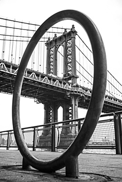 Manhattan Bridge Viewed Through A Circular Structure On The Promenade, New York City, New York, United States Of America