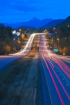Long Exposure Of Evening Traffic On The Glenn Highway Near Eagle River, Alaska, United States Of America