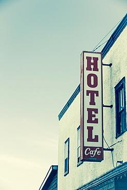 Hotel Sign On The Side Of A Building Against A Blue Sky, Saskatchewan, Canada