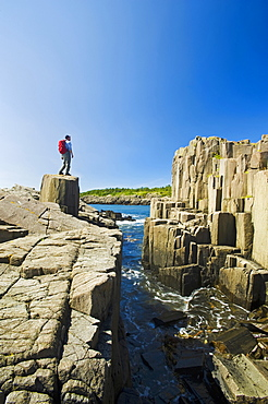 Hiker Along Basalt Rock Cliffs, Brier Island, Bay Of Fundy, Nova Scotia, Canada