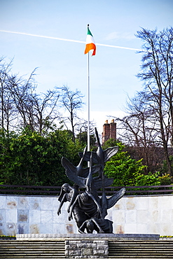 Children Of Lir Sculpture And The Republic Of Ireland Flag In The Garden Of Rememberance, Parnell Square, Dublin, Ireland