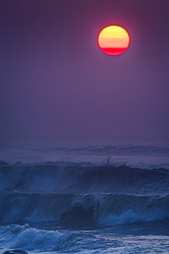 Smoke in the air colors the sun on a summer evening, Seaside, Oregon, United States of America