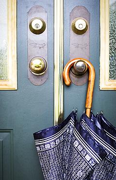 Umbrella Hanging From A Door Handle, Surrey, British Columbia, Canada
