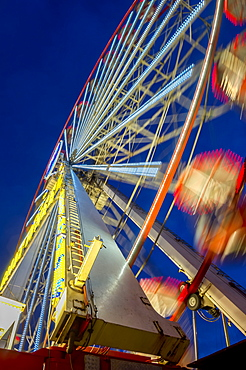 Low Angle View Of A Colourful Ferris Wheel In Motion, Newcastle Upon Tyne, Tyne And Wear, England