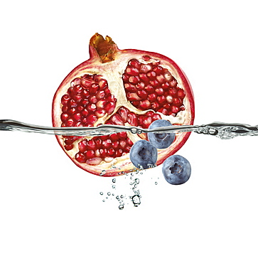 Half A Pomegranate And Blueberries Floating In Water