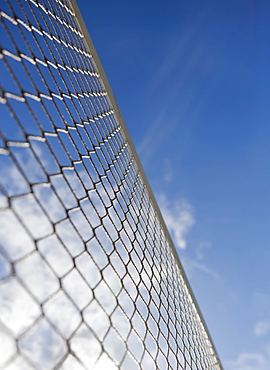 Low Angle View Of A Volleyball Net Against A Blue Sky With Cloud, Honolulu, Oahu, Hawaii, United States Of America