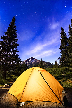 Tent And Milky Way Visible In The Sky Over Teton Range, Grand Teton National Park, Wyoming, United States Of America