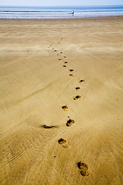 Devon, England; Footprints In The Sand At Woolacombe