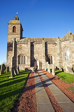 Northumberland, England; A Church And Cemetery