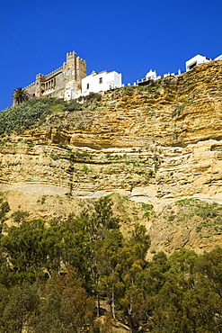 Arcos De La Frontera, Andalusia, Spain; A View Of The Old Town On Top Of A Cliff