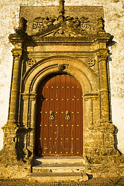 Medina Sidonia, Andalusia, Spain; The Wooden Door To The Iglesia Mayor With An Ornate Stone Frame