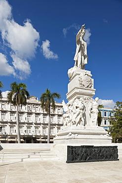 Statue Of Jose Marti (Padres De La Patria) With The Hotel Inglaterra In The Background; Havana, Cuba