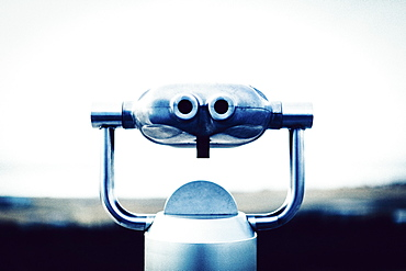 Close-up of coin-operated binoculars against clear sky