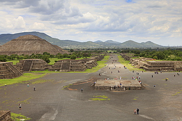 High angle view of people on street by Pyramid of the Sun against cloudy sky