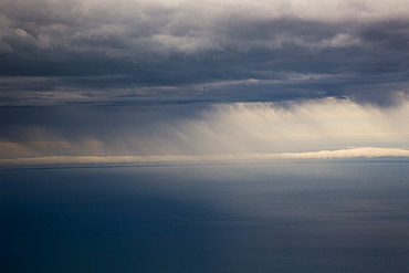 Tranquil view of sea against cloudy sky