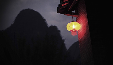 Low angle view of Chinese lantern hanging on house roof at night, Huanggyao, China