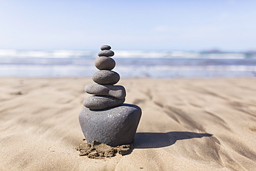 Stack of stones on beach during summer
