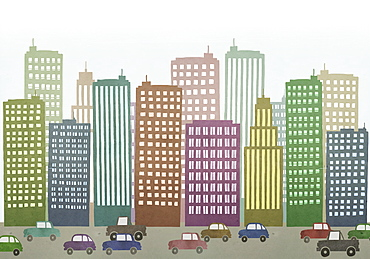 Cars moving on road by buildings in city