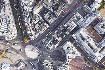 Directly above view of traffic circle amongst buildings, London, England, UK
