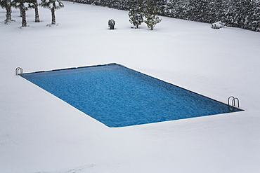 High angle view of swimming pool on snowcapped field
