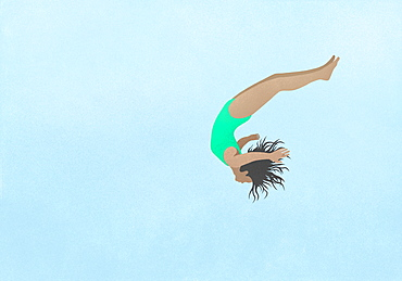Playful girl in bathing suit diving