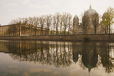 Berlin Cathedral along tranquil Spree River, Berlin, Germany