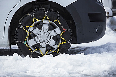 Snow chains on parked car