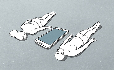 Large mobile phone between female figure lying face down and male figure lying down on back