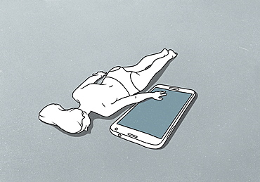 A female figure lying down with hand on a large mobile phone